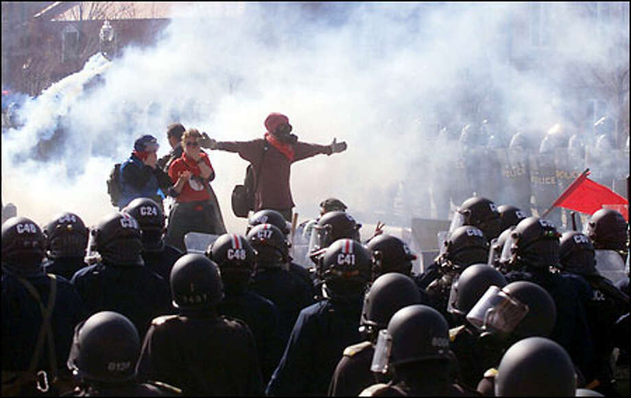 Protesters challenge riot police outside the site of the Summit of the Americas in Quebec City. Photo: / Associated Press