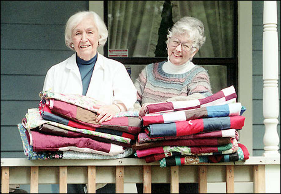 Ingrid Cushing and Janice Leaf with some of the quilts they have made for poor children. The quilts will be sent to World Concern, a Seattle-based Christian relief organization. The women fashion the quilts in their homes in Granite Falls. Photo: Phil H. Webber/Seattle Post-Intelligencer
