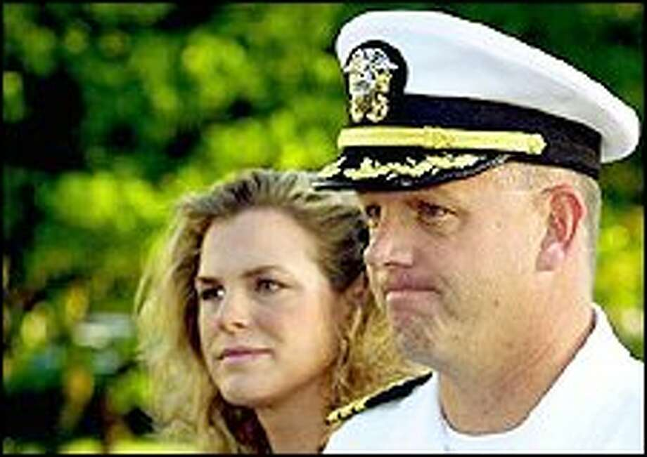 Commander Scott Waddle, with his wife Jill, in a file photo. Waddle, who was the captain of the USS Greenville that struck a Japanese fishing boat, will not be court martialed, but his naval career is over. Photo: AP