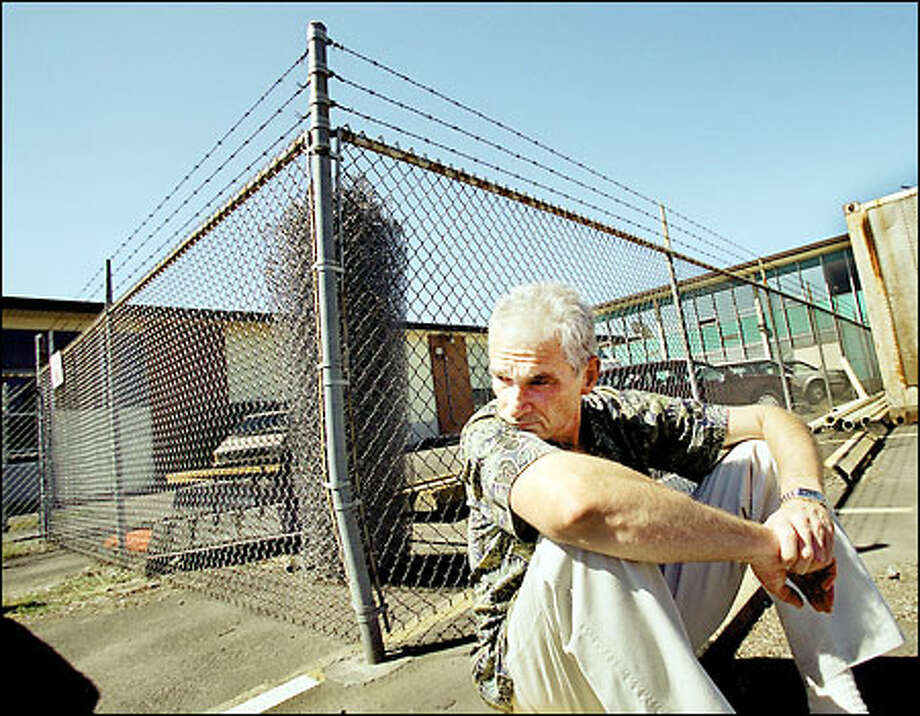 Tim Amundson, 53, says he was sexually abused by a staff member when he was 7 years old at the Washington School for the Deaf in Vancouver. He said he is disgusted with the security fence outside the school. The problem, he said, is on the inside. Amundson was just 5 when he first enrolled. Photo: Renee C. Byer/Seattle Post-Intelligencer