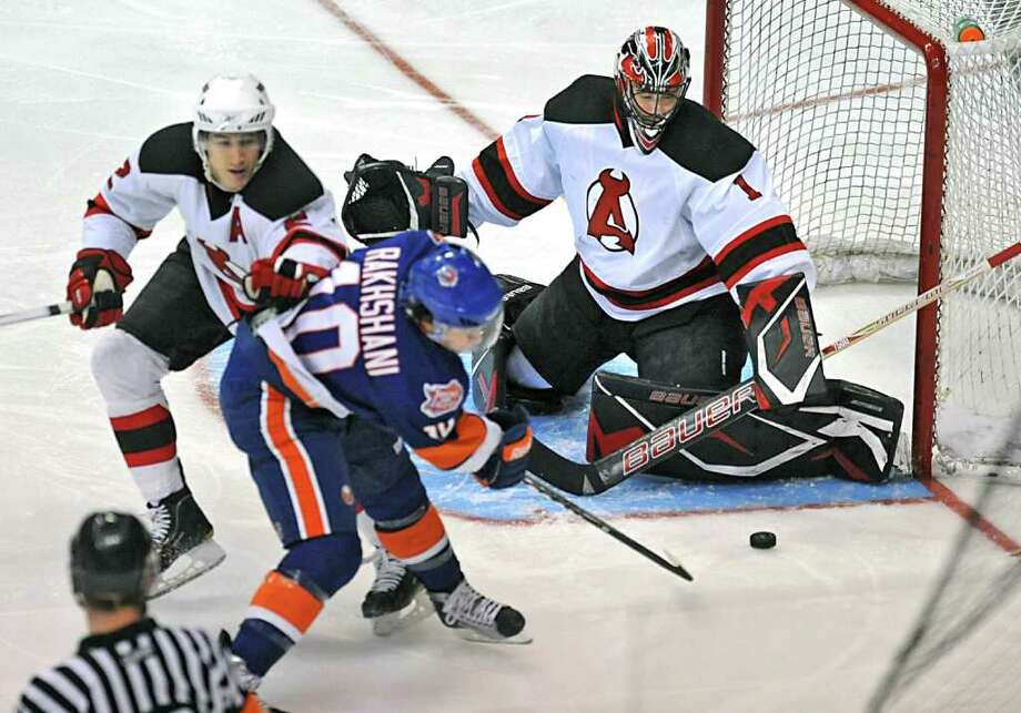 Rhett Rakhshani, of Bridgeport, tries to score but Goalie Mike McKenna, of the Albany Devils, stops the puck during a hockey game at the Times Union Center in Albany, NY on Wednesday, March 9, 2011. (Lori Van Buren / Times Union) Photo: Lori Van Buren