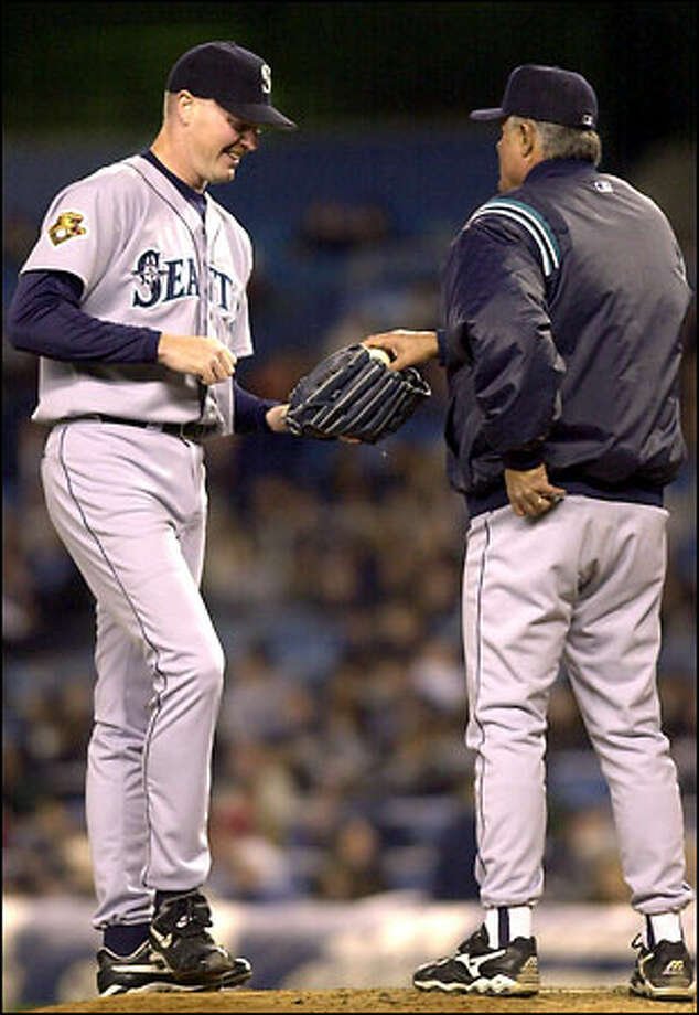 Mariners reliever and former Yankee Jeff Nelson smiles as he receives the ball from manager Lou Piniella last night. Photo: / Associated Press