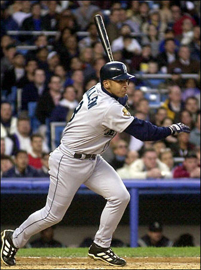 Carlos Guillen connects for a second-inning single that, thanks to an error by right fielder Paul O'Neill, scored three runs. The Mariners shortstop, who drove in the go-ahead run in the sixth inning, was 3-for-4 with three runs batted in, raising his average to .209. Photo: / Associated Press