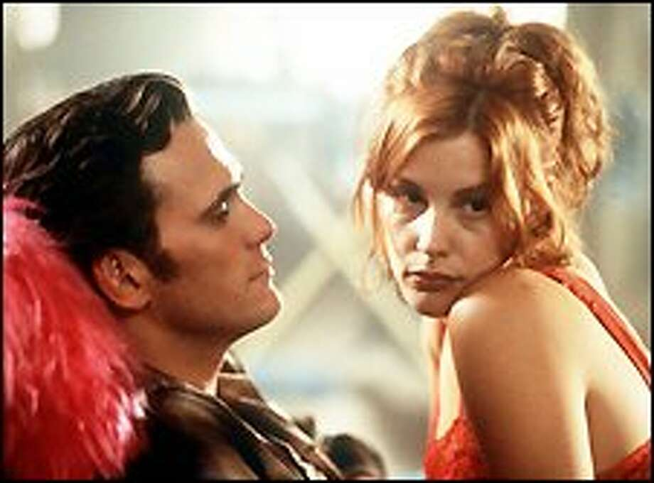 """Matt Dillon and Liv Tyler appear in a scene from USA Films' black comedy """"One Night at McCool's"""" in this 2001 promotional photo. Tyler plays an opportunistic vixen who becomes the object of desire for every man she encounters. / USA FLMS"""