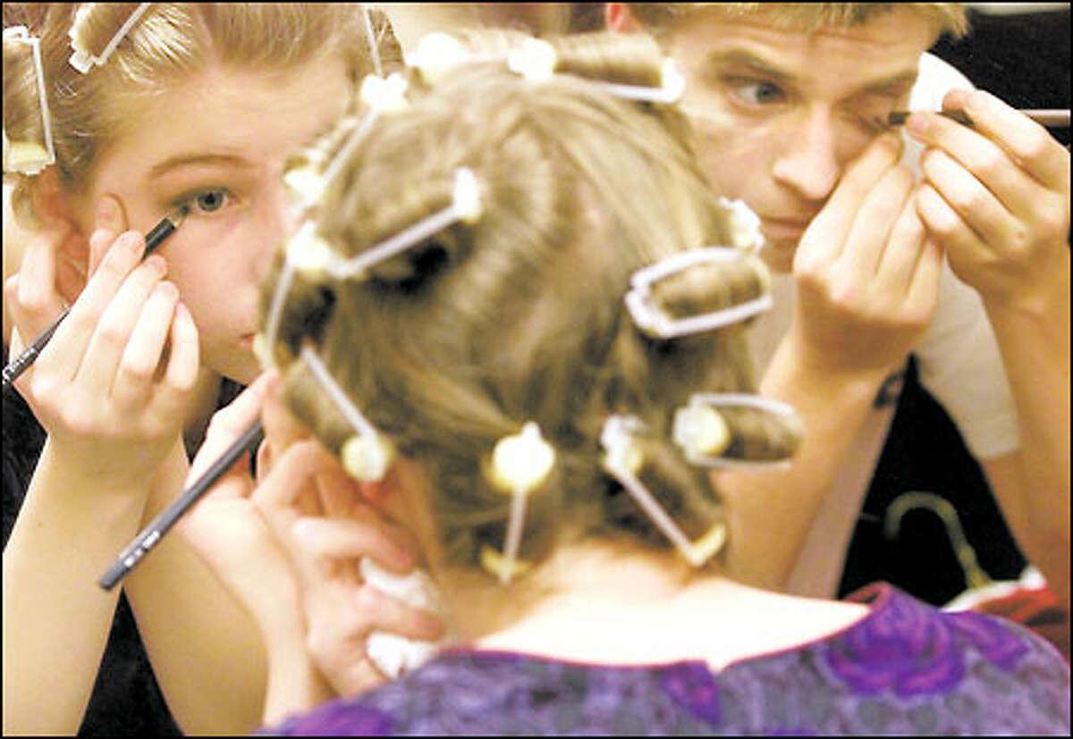"Junior Amanda Gouldthorpe prepares her makeup for ""Annie."""