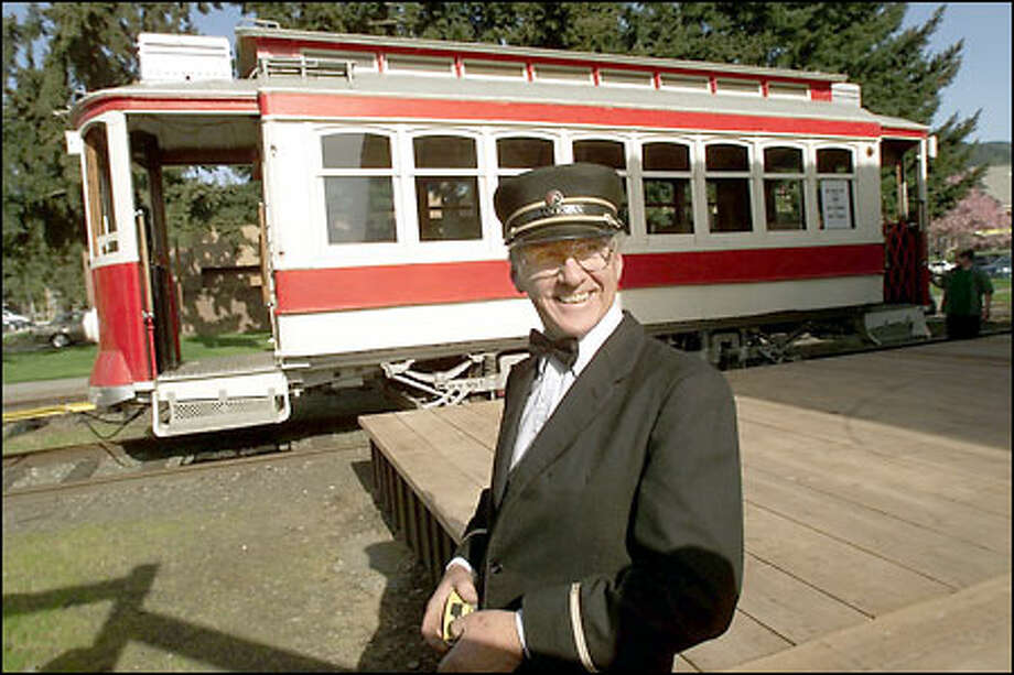 Denny Croston, a member of the Issaquah Valley Trolley Team, dresses the part as motorman for the city's trolley. The city hopes the 1927 streetcar, leased from Yakima, will help bring vitality to downtown for now and possibly help ease traffic congestion in the future. Photo: Paul Kitagaki Jr./Seattle Post-Intelligencer