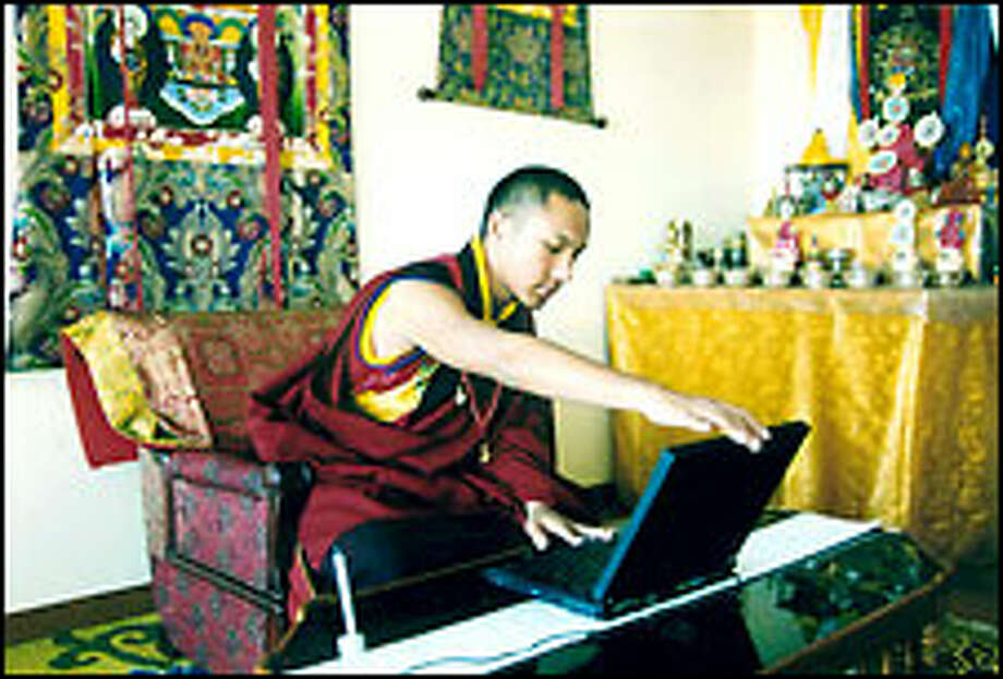Ugyen Thinley Dorje, the 17th Karmapa, works on a laptop computer at Gyuto Monastery near Dharmsala in northern India. The 15-year-old Buddhist monk who fled Chinese-controlled Tibet last year has won refugee status. Photo: AP PHOTO