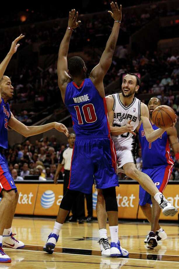 SPURS -- San Antonio Spurs Manu Ginobili looks to pass under pressure from Detroit Pistons Tayshaun Prince and Greg Monroe in the second half at the AT&T Center, Wednesday, March 9, 2011. The Spurs won 111-104. JERRY LARA/glara@express-news.net Photo: JERRY LARA, San Antonio Express-News / SAN ANTONIO EXPRESS-NEWS (NFS)
