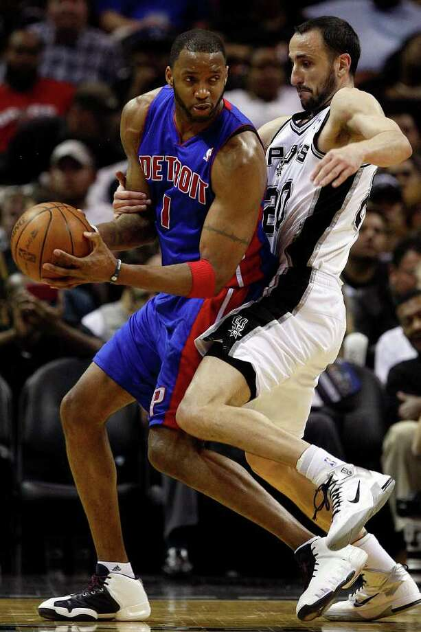 SPURS -- San Antonio Spurs Manu Ginobili tries to draw a foul from Detroit Pistons Tracy McGrady in the second half at the AT&T Center, Wednesday, March 9, 2011. The Spurs won 111-104. JERRY LARA/glara@express-news.net Photo: JERRY LARA, San Antonio Express-News / SAN ANTONIO EXPRESS-NEWS (NFS)