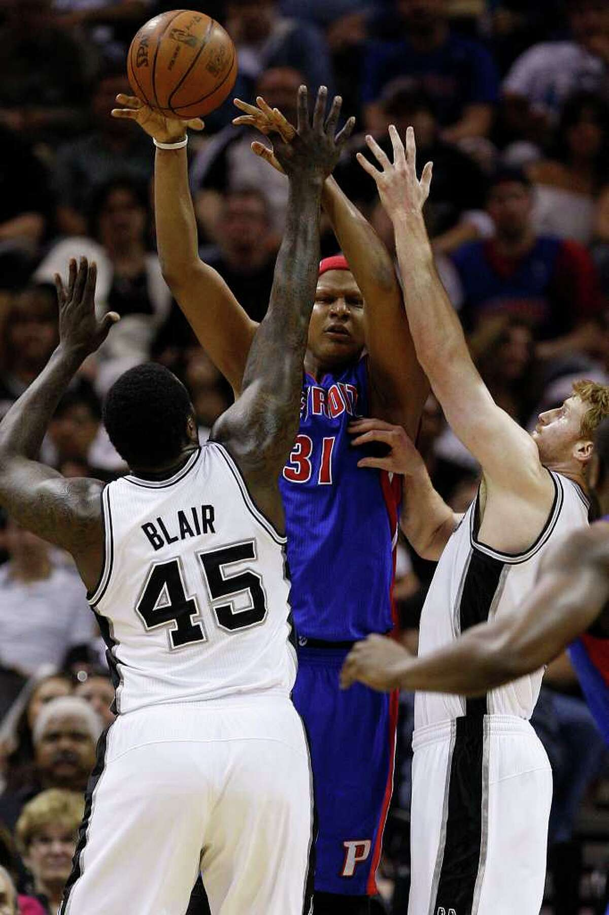 SPURS -- Detroit Pistons Charlie Villanueva gets pressure from San Antonio Spurs DeJuan Blair and Matt Bonner in the first half at the AT&T Center, Wednesday, March 9, 2011. JERRY LARA/glara@express-news.net