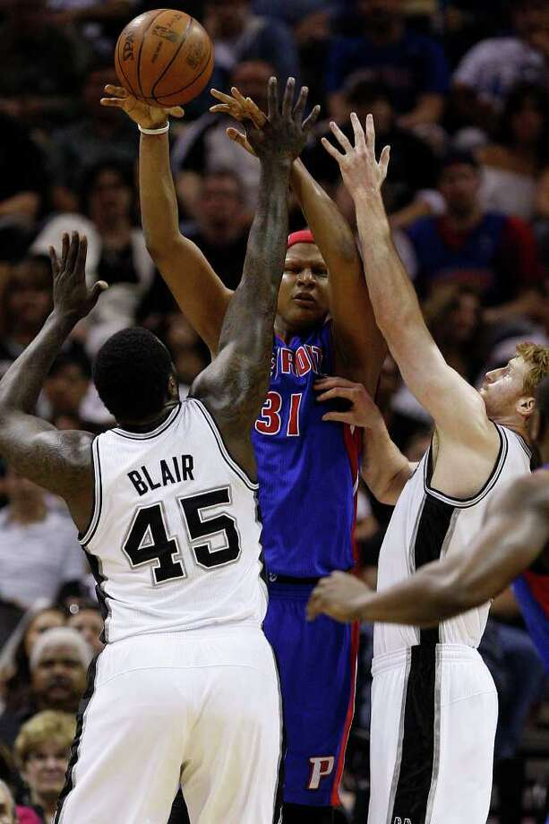 SPURS -- Detroit Pistons Charlie Villanueva gets pressure from San Antonio Spurs DeJuan Blair and Matt Bonner in the first half at the AT&T Center, Wednesday, March 9, 2011. JERRY LARA/glara@express-news.net Photo: JERRY LARA, San Antonio Express-News / SAN ANTONIO EXPRESS-NEWS (NFS)