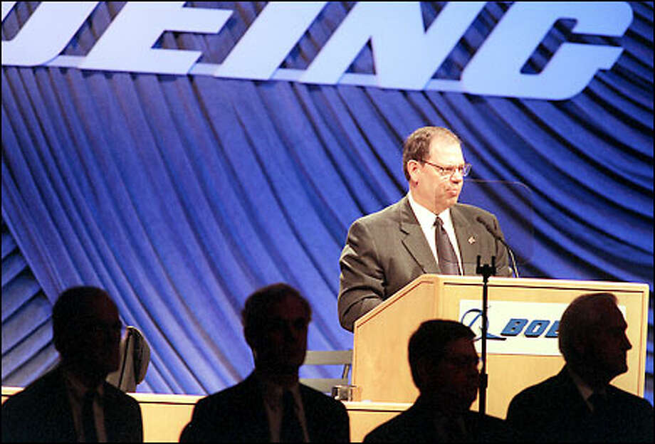 Boeing CEO Phil Condit speaks at the annual shareholders meeting. His remarks on the area's business climate were the strongest criticisms yet from the company. Photo: Paul Joseph Brown/Seattle Post-Intelligencer