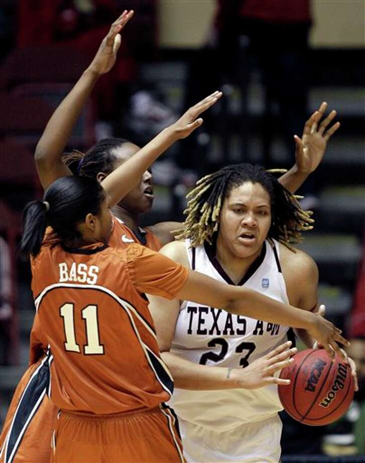 Texas A&M's Danielle Adams (23) heads to the basket past Texas' Anne Marie Hartung during the first half of the Aggies' Big 12 tournament quarterfinal victory. JEFF ROBERSON/ASSOCIATED PRESS