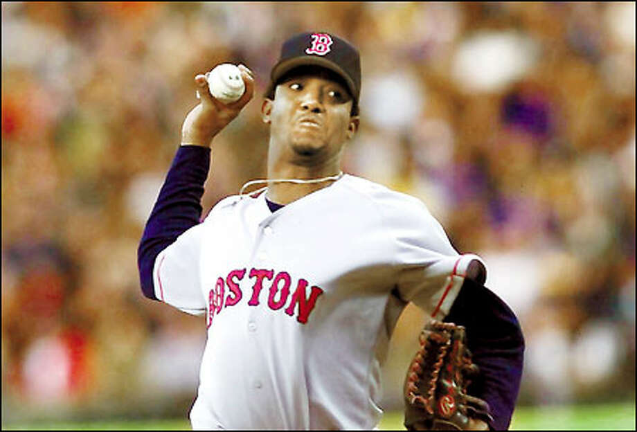 Three-time Cy Young Award winner Pedro Martinez allowed only three hits in eight innings. The Mariners lost their second game in a row for the first time this season. Photo: Gilbert W. Arias/Seattle Post-Intelligencer