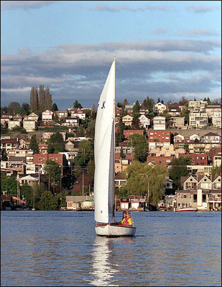 One of the small wooden sailboats in the SailNOW! instructional program at the Center for Wooden Boats makes its way across Lake Union. Photo: Gilbert W. Arias/Seattle Post-Intelligencer