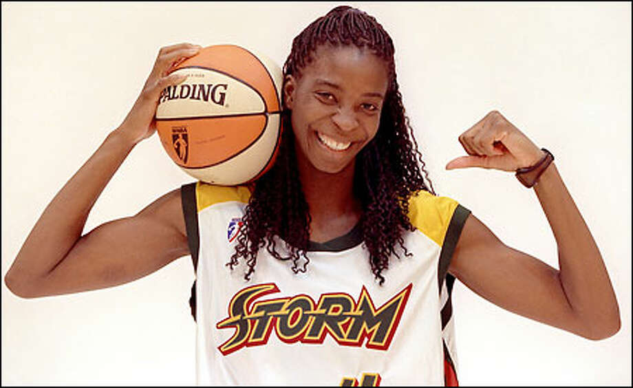 Simone Edwards, the Storm's 6-foot-4 center, shows off her muscles -- and her smile -- during Media Day. Photo: Grant M. Haller/Seattle Post-Intelligencer