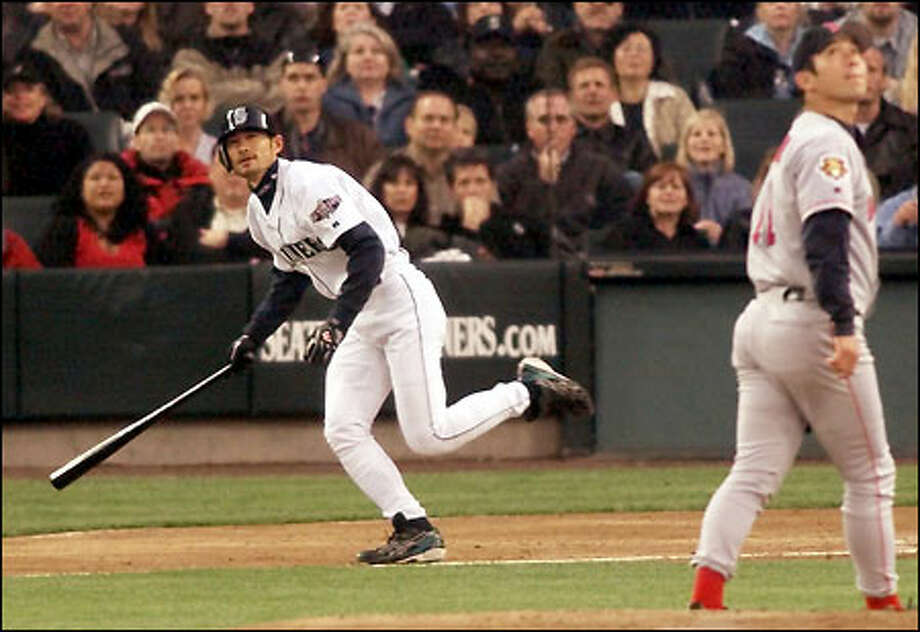 Ichiro Suzuki and Red Sox starter Hideo Nomo watch Ichiro's pop fly in the third inning. Nomo would go on to lose the game after departing in the sixth inning, trailing 3-1. Photo: Mike Urban/Seattle Post-Intelligencer