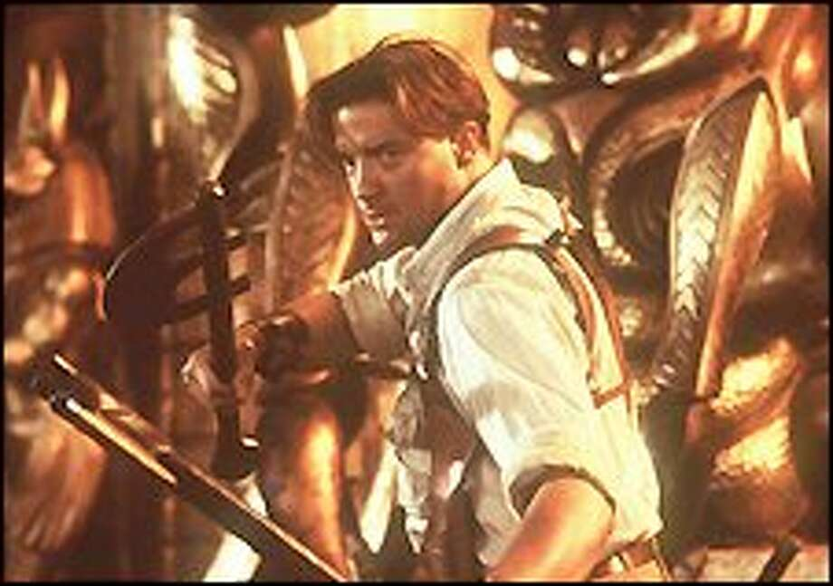 """Adventurer Rick O'Connell, played by Brendan Fraser, prepares to fight against Imhotep and his forces of the undead in """"The Return of the Mummy."""""""