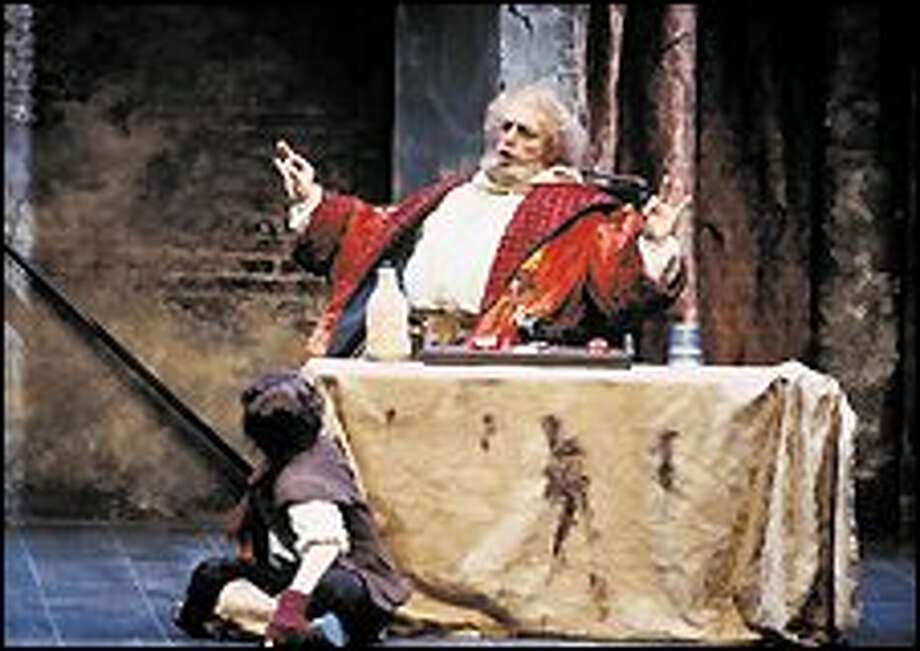 Sir John Falstaff, played by Alfonso Antoniozzi, displays his expansive self in Seattle Opera's production of the Verdi comedy based on Shakespeare plays.