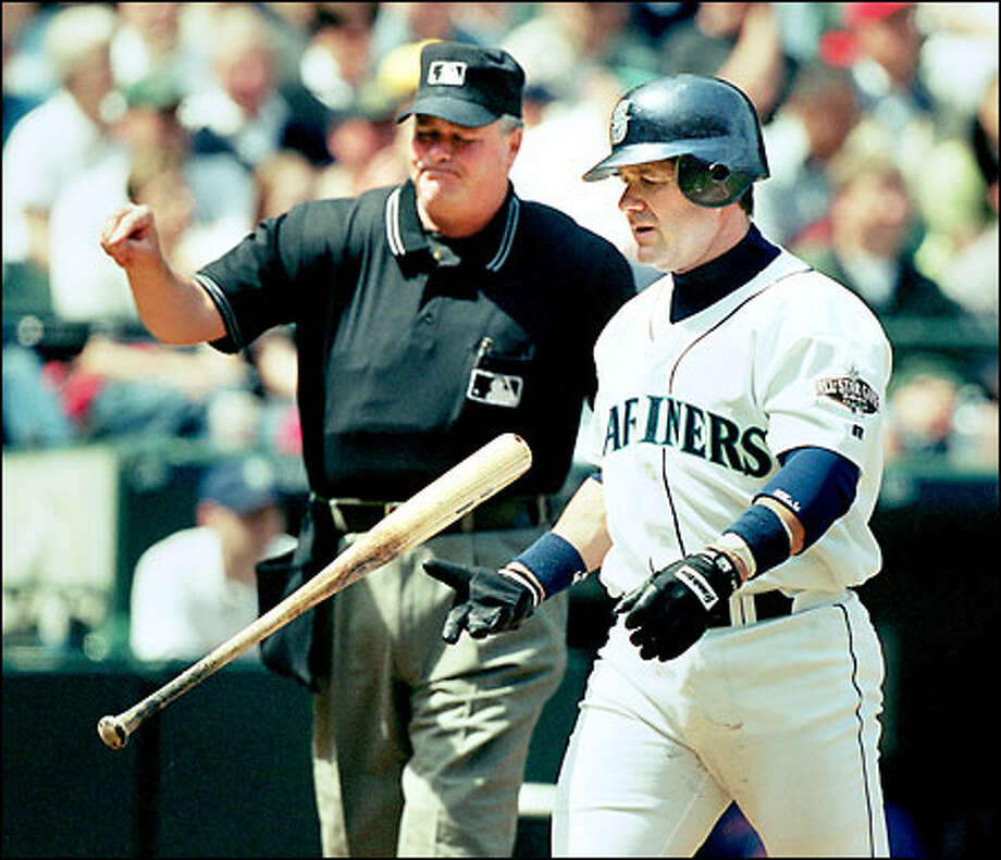 Edgar Martinez flips his bat after striking out in the first inning against Toronto's Chris Carpenter. Photo: Dan DeLong/Seattle Post-Intelligencer