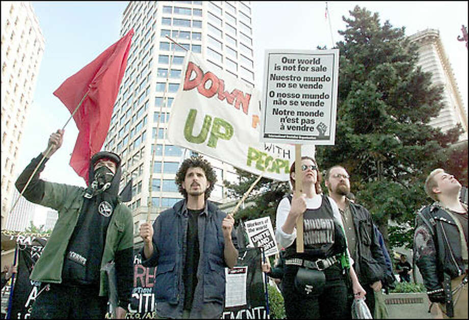 Protesters marched around the Westin Hotel last night to protest the 2001 Asia Pacific Cities Summit. The crowd was estimated to be about 40 people. Photo: Meryl Schenker/Seattle Post-Intelligencer