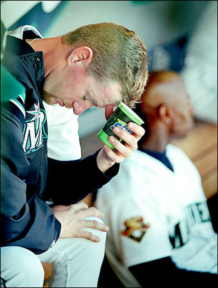 Mariners relief pitcher Ryan Franklin sits in the dugout after giving up five runs to the Toronto Blue Jays in the seventh inning. Franklin allowed six runs in three innings, including three home runs. Photo: Dan DeLong/Seattle Post-Intelligencer