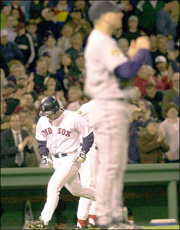 Boston's Chris Stynes rounds third base after hitting a two-run homer off Brett Tomko in the fifth inning. Photo: / Associated Press