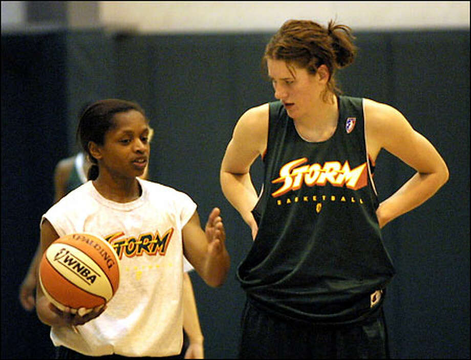 Storm No. 1 draft pick, Lauren Jackson, right, gets some advice from veteran Seattle guard Sonja Henning during practice on Monday. Photo: / Associated Press