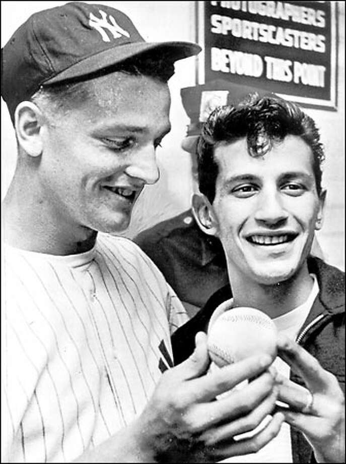 After Sal Durante caught Roger Maris' 61st home run, it earned him a trip to Seattle for a publicity stunt and $6,000. Photo: / Associated Press