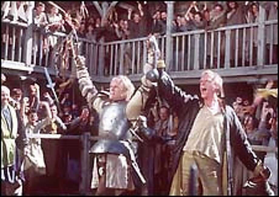 Heath Ledger (left) and Paul Bettany (right) celebrate one of the young knight's many victories on the tournament field. / COLUMBIA PICTURES