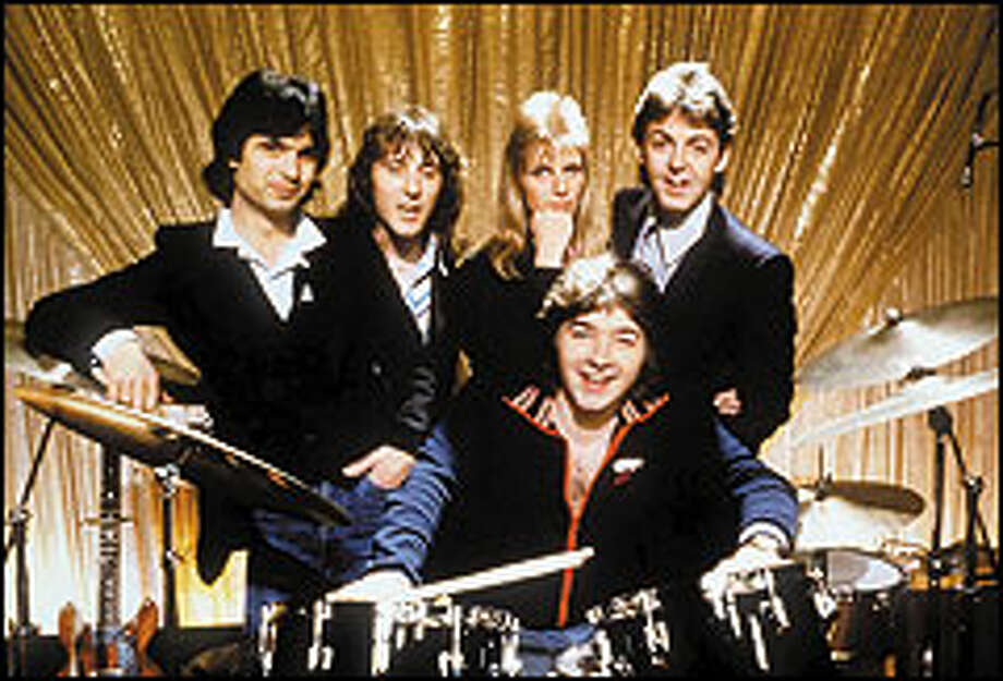 """Paul McCartney, right rear, and his wife, Linda, pose with members of Wings in an undated publicity photo from the 1970s. """"Wingspan"""" traces the band's evolution over a decade and includes clips from its 1976 Kingdome concert. Photo: AP File"""
