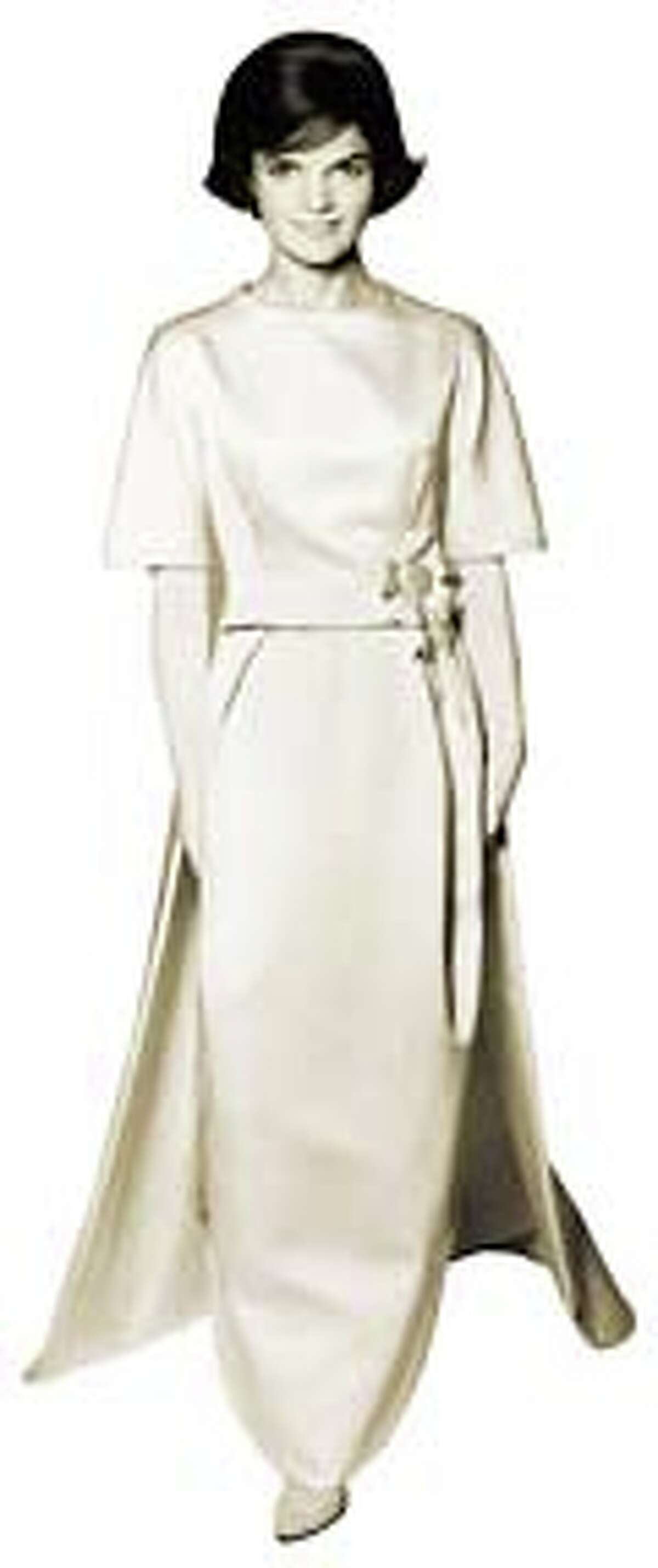 Oleg Cassini designed this gown of ivory double-faced silk satin twill for Jackie Kennedy to wear to the inaugural gala in 1961. It projected an image of Jackie as a woman of commanding personal style.