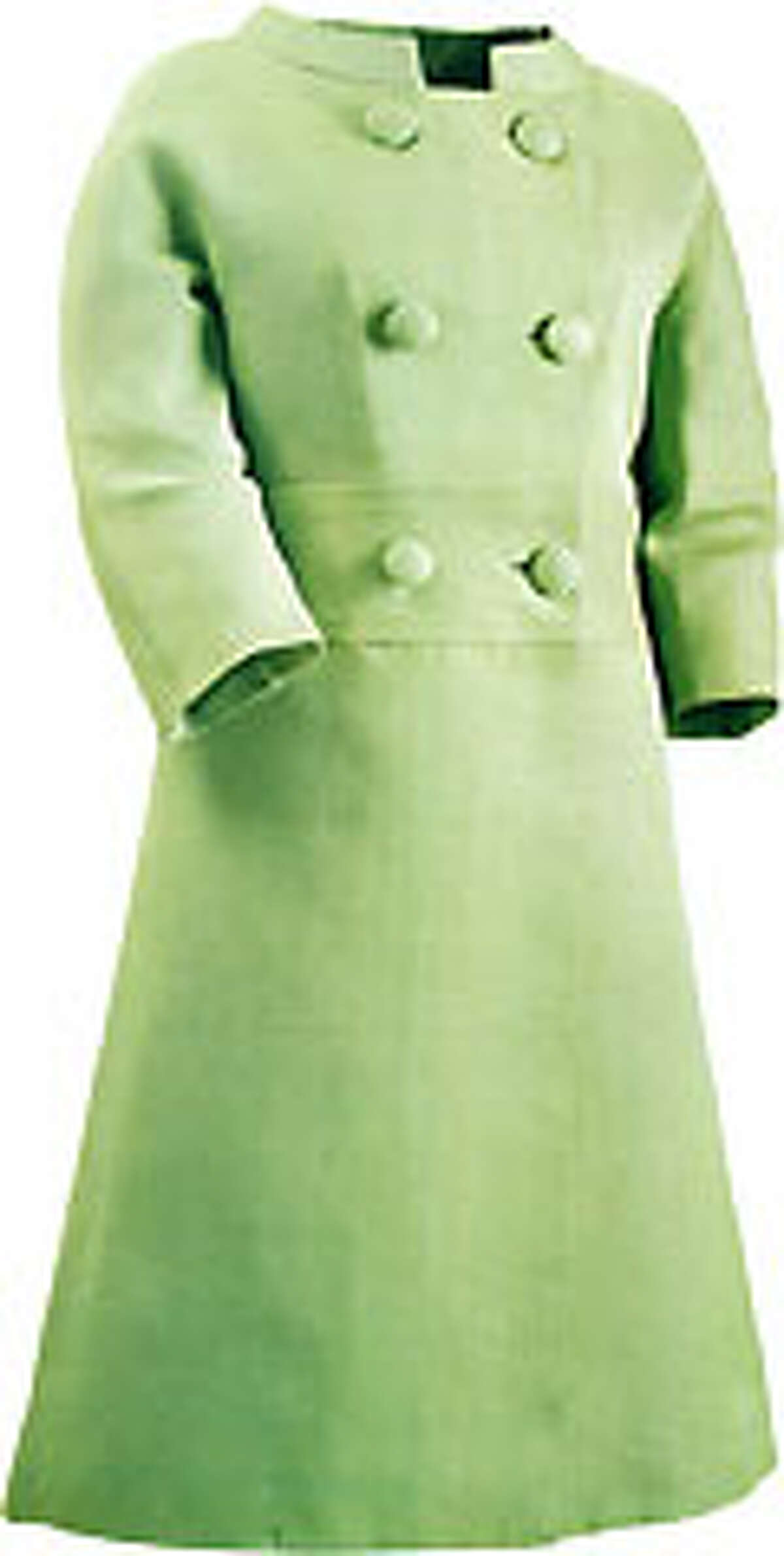 On a trip to Mexico City with President Kennedy in 1962, Jackie wore this Oleg Cassini-designed coat with matching suit in leaf green silk gazar.