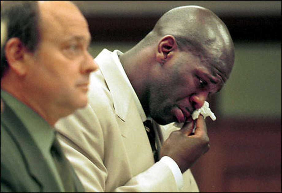 With attorney John Wolfe by his side, Ruben Patterson wipes away tears during his sentencing. Patterson was ordered to spend 15 days in jail. Photo: / Associated Press
