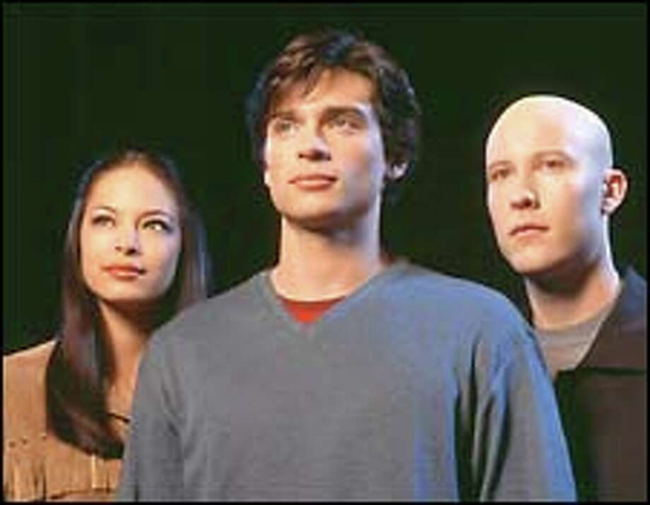 "Tom Welling, center, plays the teenage Clark Kent during his formative years in ""Smallville."" The new WB show also features Kristin Kruek, left, as his girlfriend, Lana Lang, and Michael Rosenbaum as future adversary Lex Luthor."