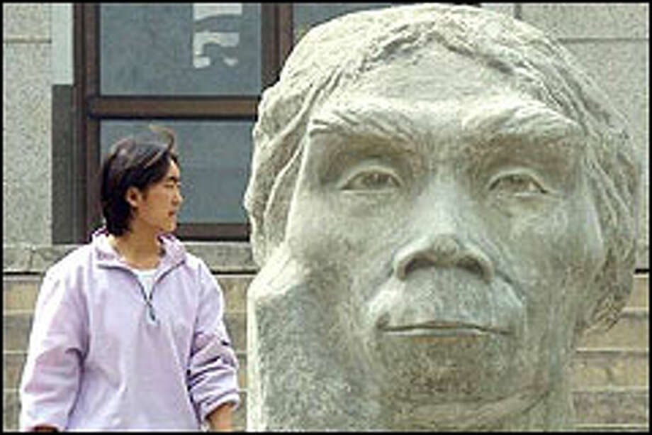 A bust of Peking Man at Peking Man Park. Fourteen years after it was proclaimed a U.N. World Heritage Site, the park isn't on most tours. Photo: AP