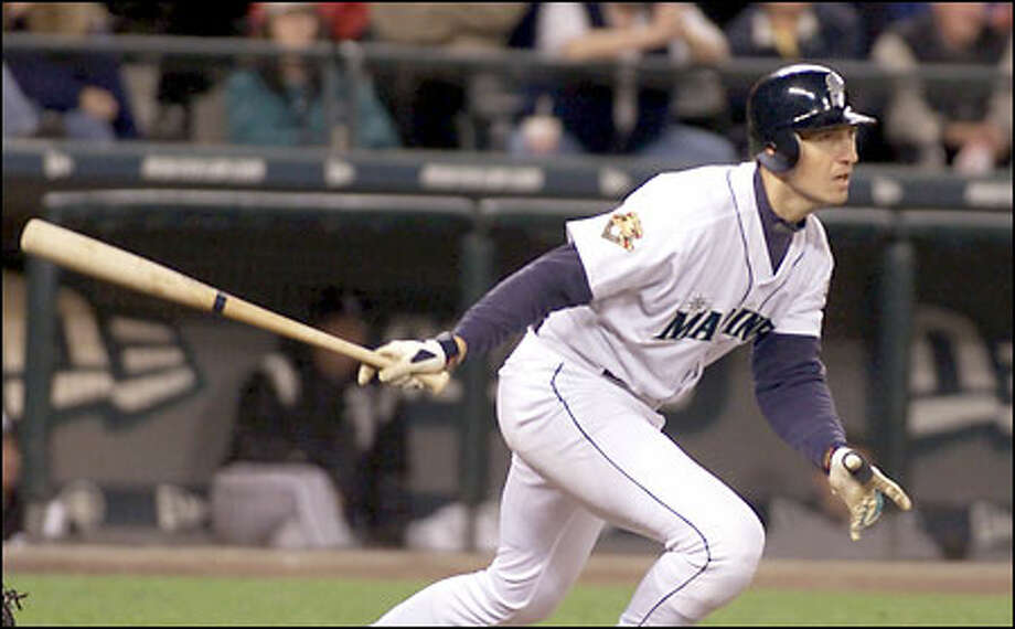 John Olerud follows through as his two-run double sails into the right-field corner in the seventh inning, giving the Mariners a 5-2 lead. Seattle scored all seven of its runs with two outs. Photo: / Associated Press