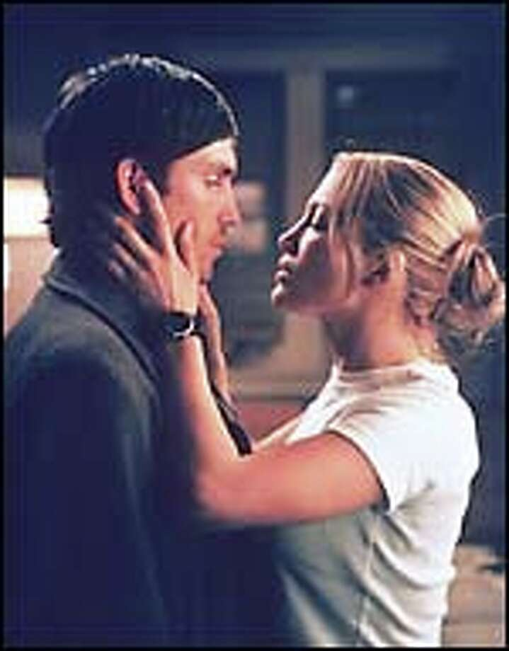 A gentle wanderer (Jim Caviezel) and a tough cop (Jennifer Lopez) find love and try to heal their trauma-scarred lives.