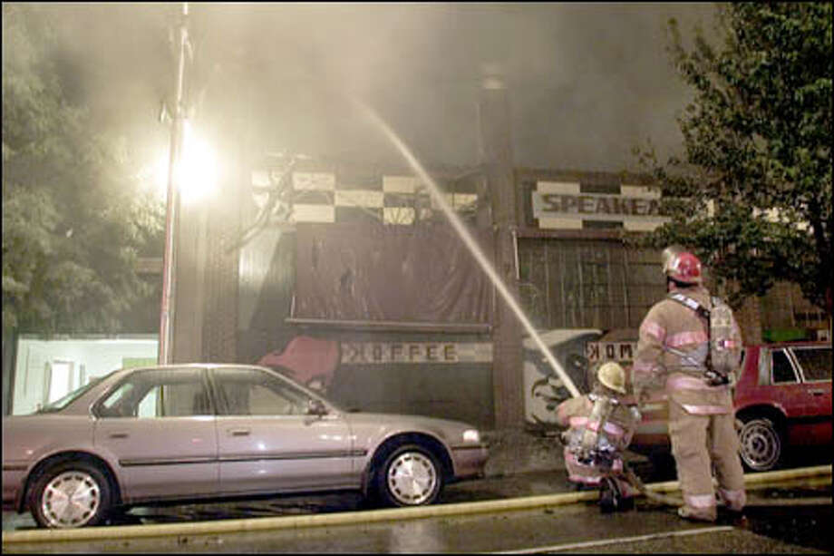 Firefighters combat a blaze that raced through the Belltown building housing the Speakeasy Cafe and other businesses Friday night. Photo: Paul Kitagaki Jr./Seattle Post-Intelligencer