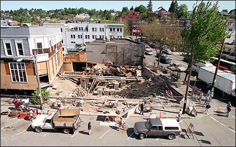A mixed-use complex with apartments atop shops will fill the hole once occupied by the landmark Red Door Ale House at North 34th Street and Fremont Avenue North. The building is moving one block west. Owner Suzie Burke will keep her offices in the Red Door. Photo: Paul Joseph Brown/Seattle Post-Intelligencer
