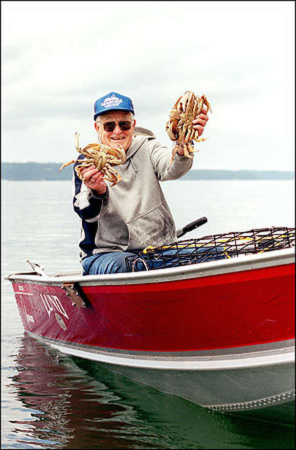 "Owen ""Mike"" Hunt shows off some of the Dungeness crabs he caught near his Camano Island home. Photo: Dan DeLong/Seattle Post-Intelligencer"
