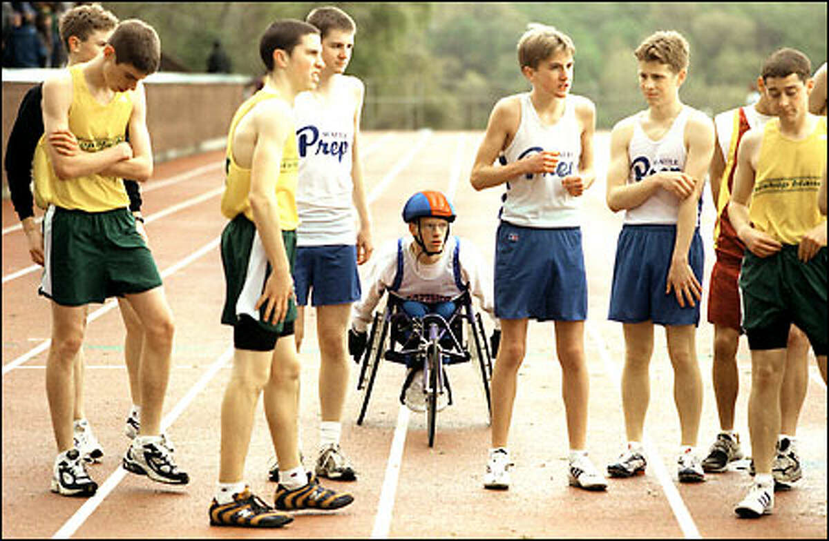 Alistair Patrick, who often competes against non-wheelchair athletes, gets set behind other competitors before a 3,200-meter race at West Seattle Stadium.