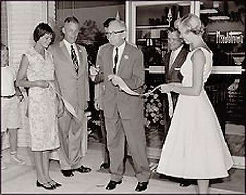 1aac8e3458a John W. Nordstrom cuts the ribbon at the July 1958 opening of the Bellevue  Nordstrom
