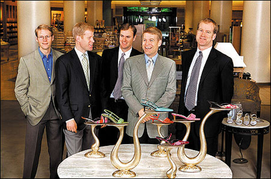 Investors breathed a sigh of relief when  members of the Nordstrom family, pictured here in the downtown Seattle store, again took control. From left is: Dan, Erik, Jamie, Blake and Peter. Photo: Paul Joseph Brown/Seattle Post-Intelligencer