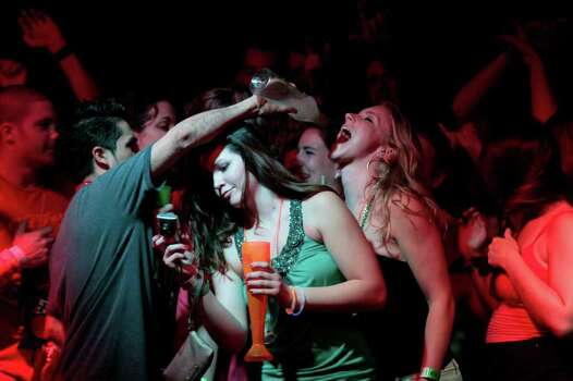 A bartender pours a margarita from a bottle into a young woman's mouth at a nightclub during Spring Break in Cancun, Mexico, early Wednesday March 9, 2011. Cancun is still a top foreign destination for Spring Break. Photo: AP