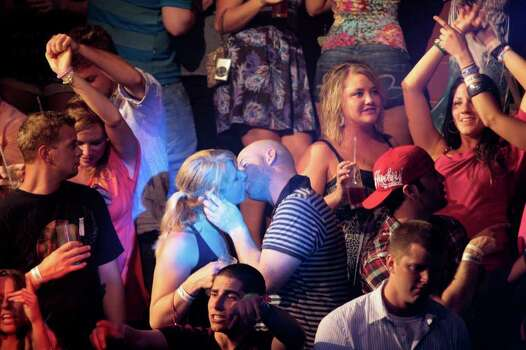 A couple kisses at a nightclub during Spring Break in Cancun, Mexico, early Wednesday March 9, 2011. Cancun is still a top foreign destination for Spring Break. Photo: AP