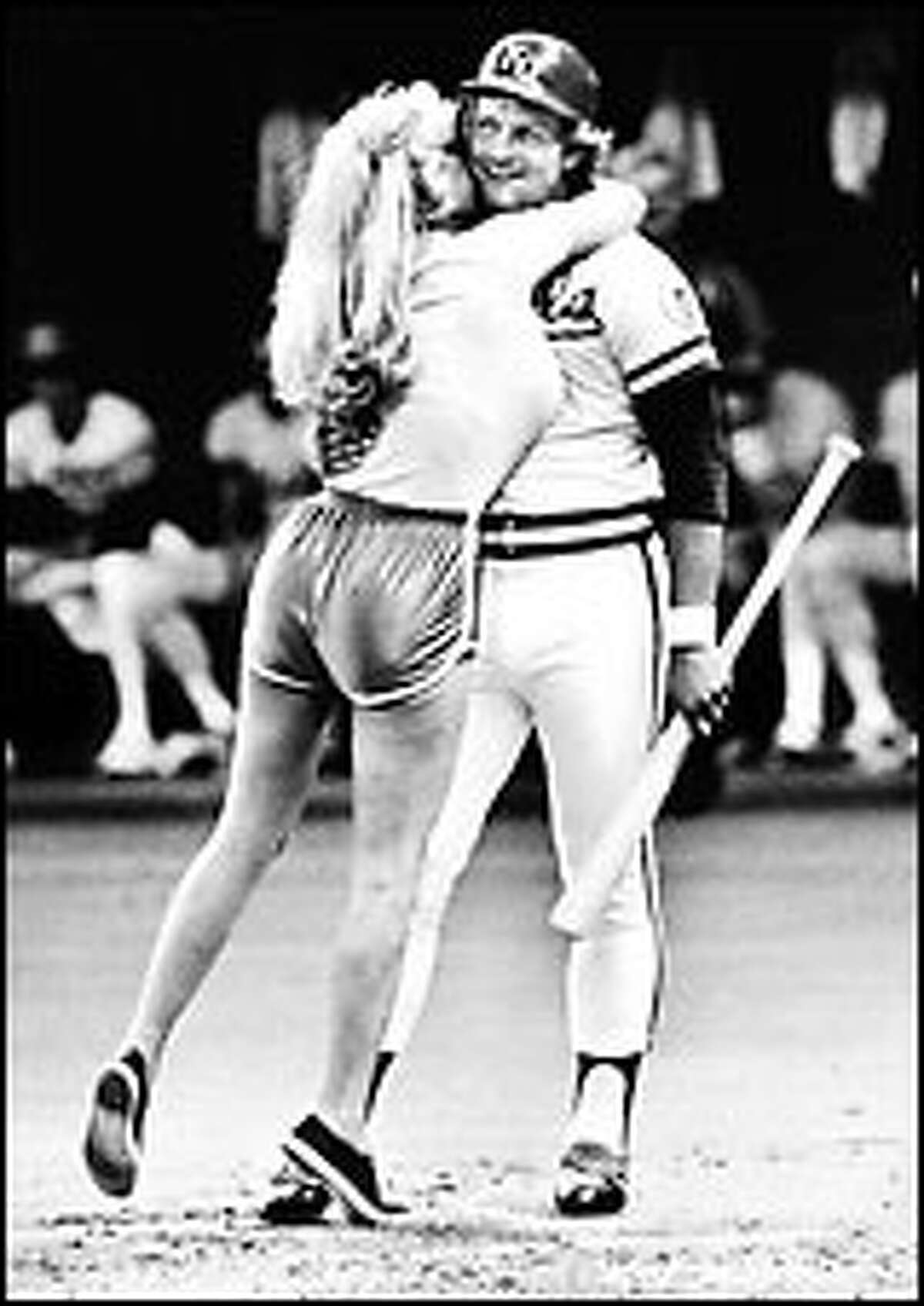 Morganna latches on to George Brett during the 1979 All-Star Game in the Kingdome. Click for a larger image