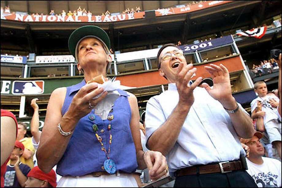 Lynda and John Olerud Sr. of Bellevue watch the Home Run Derby from their seats. Tonight, they'll watch their son John take the field as the starting first baseman for the AL All-Stars. Photo: Mike Urban/Seattle Post-Intelligencer
