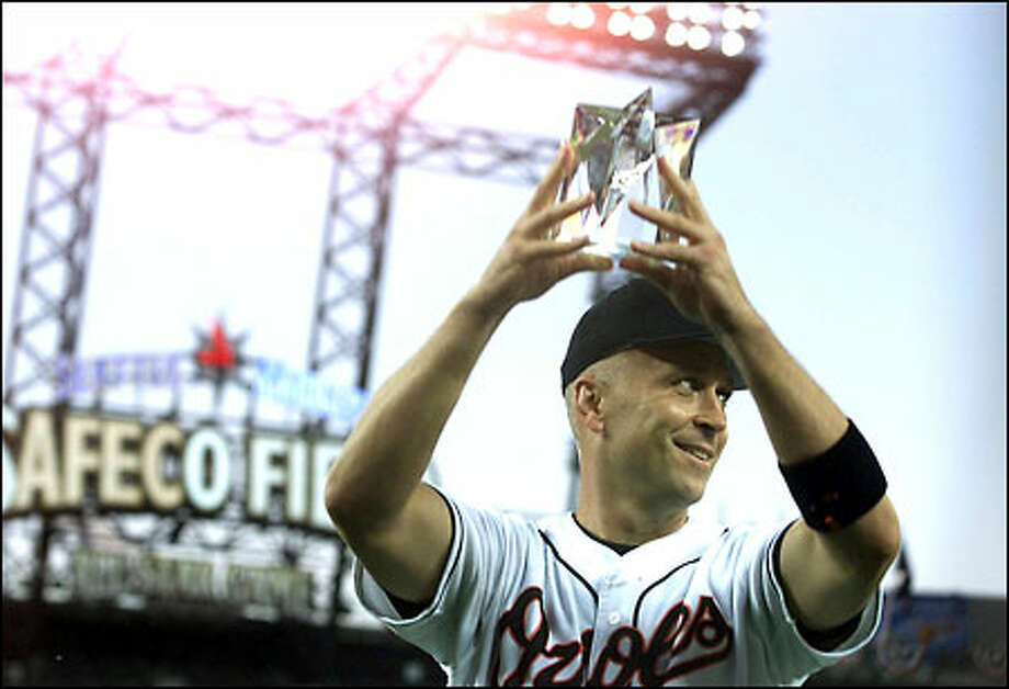 Cal Ripken displays the trophy for being named MVP of the All-Star Game. Ripken opened the scoring with a home run in the third inning to give the American League a lead it never relinquished. Photo: Dan DeLong/Seattle Post-Intelligencer