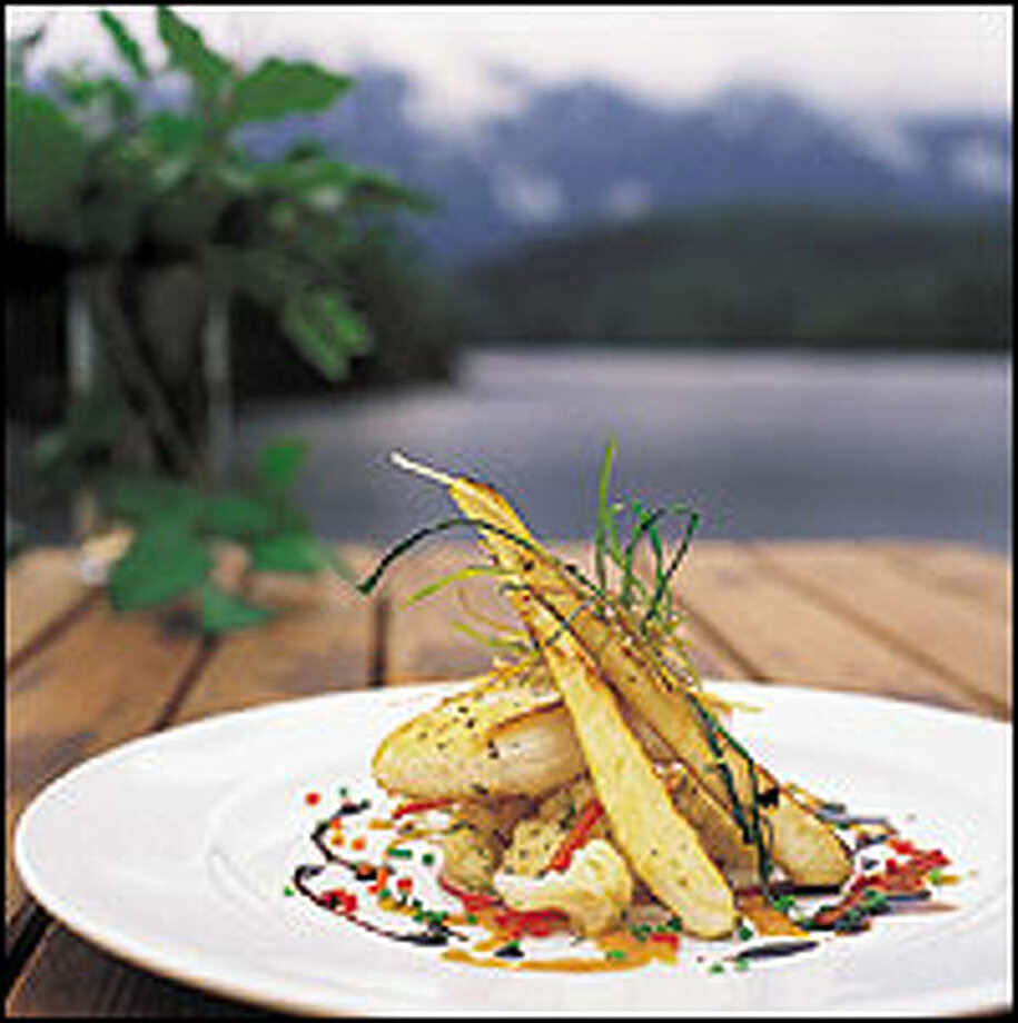 Chef Timothy May creates gourmet meals, whipped up in an outdoor cedar kitchen and cooked over an open fire. Photo: CLAYOQUOT  WILDERNESS RESORT PHOTOS